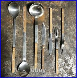 Peter Raacke Mono-t stainless and teak flatware. 1960. 76 Pieces Service For 8